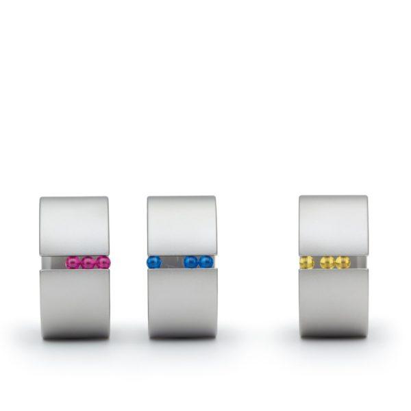 Composition anneaux Abakus en acier couleur rose bleu et or Niessing